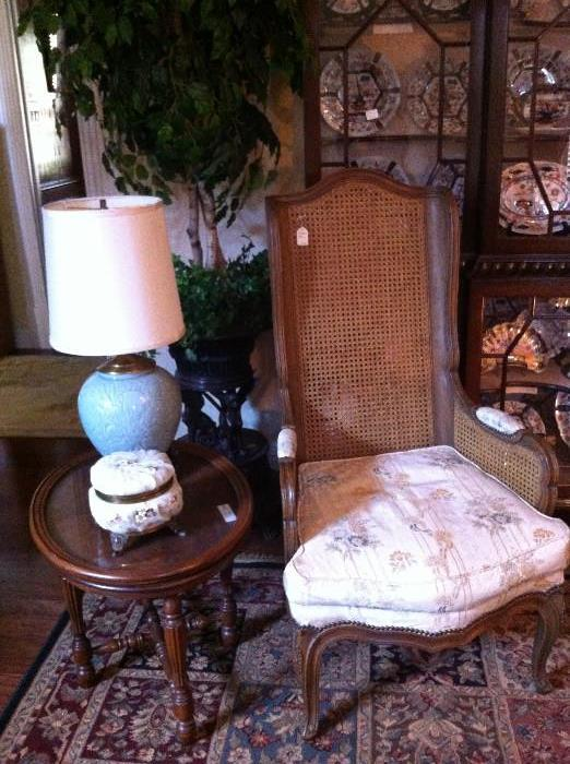 double caned chair; small oval table; decorative hinged box; lovely lamp