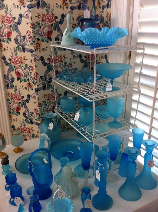 assortment of blue glassware