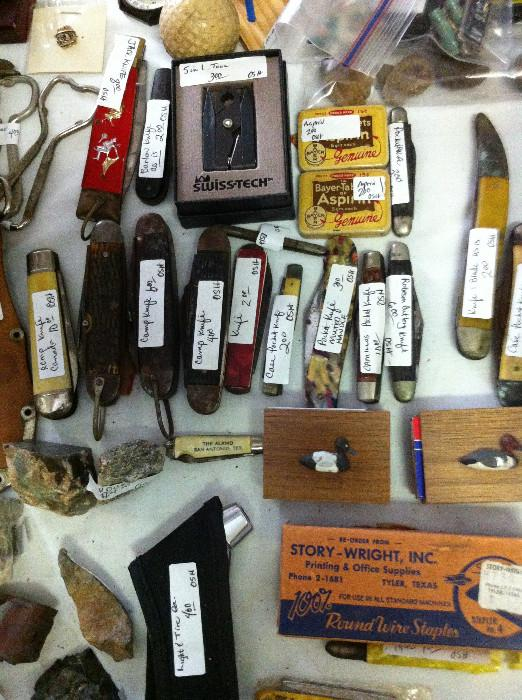 many pocket knives; Tyler memorabilia