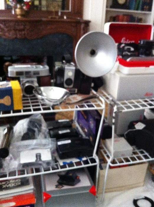 HUGE amt.of cameras & equip. (Leica, Kodak, Cannon, tripods, cases, lens);