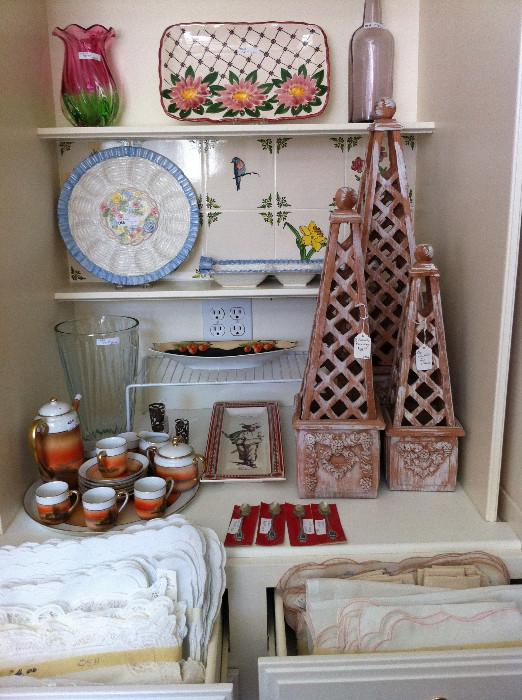 many decorative items; tea sets; lovely linens
