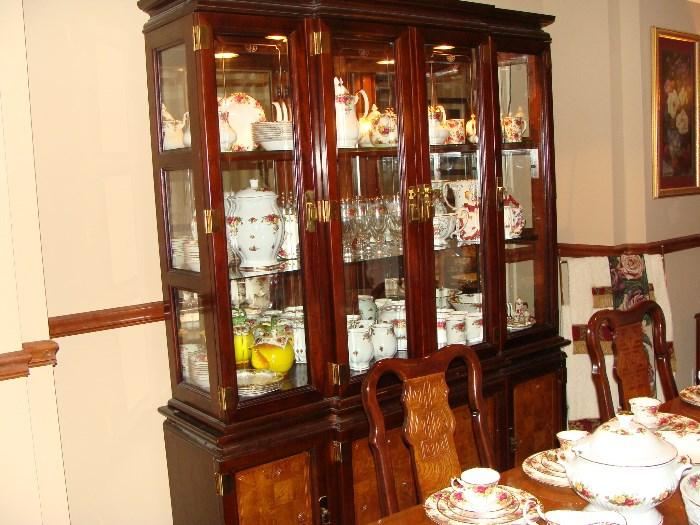 A view of the china cabinet and dining chairs plus Country Rose China.