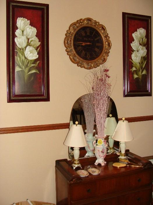 Waterfall Mirrored Dresser, with vintage lamps, dresser items, vase, framed wall prints and Rococo style wall clock