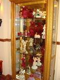 Lighted gold China Cabinet with glass shelves beautiful items inside. Each item is individually pictured to give you the best viewing experience.