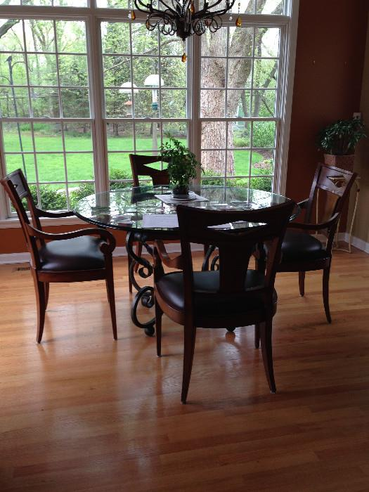 Large Beveled glass table with 4 wood/leather chairs with arms