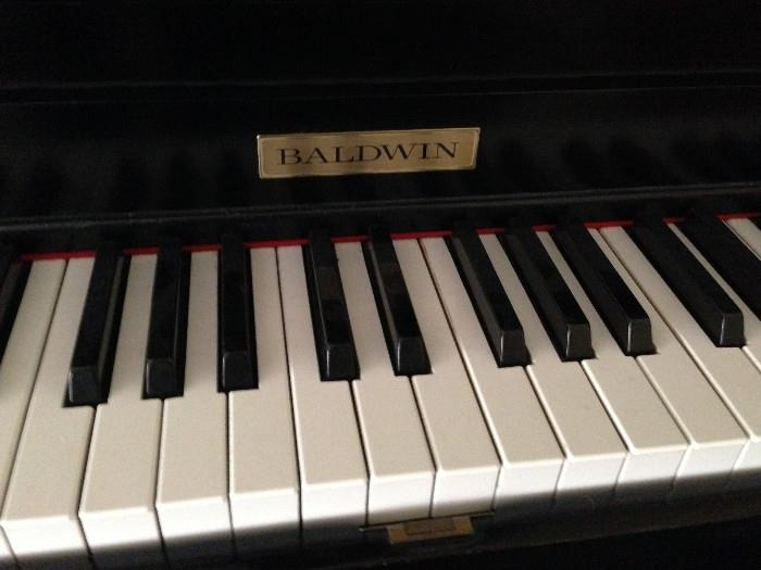 Baldwin Black lacquer upright Piano...excellent condition and sheet music included!