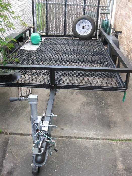2000 LB. 6X8 UTILITY TRAILER USED ONLY A FEW TIMES...BRING A BOLT CUTTER TO CUT OFF HITCH PADLOCK