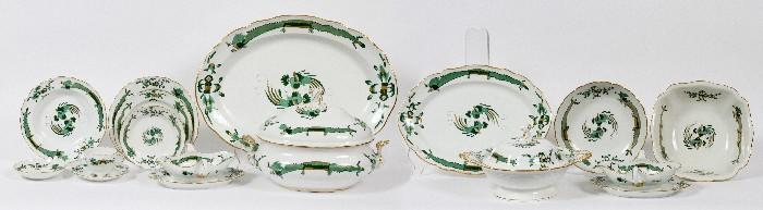 """Lot#1013, MEISSEN 'GREEN DRAGON' PORCELAIN DINNER SERVICE, C. 1920, 109 PIECES//Including two oval serving platters at L. 16"""" and 21 1/2"""", 1 round serving dish at 10"""", 1 covered vegetable at H. 8"""" x 13"""", 1 square serving dish at 11"""", 2 gravy boats with attached underplates, 1 covered soup tureen at H. 11"""" x 14"""", 1 fish platter at 24"""", 13 bread and butter plates at 6 1/4"""", 12 luncheon plates at 8 1/2"""", 16 dinner plates at 9 3/4"""", 16 rim soup bowls, 12 dessert plates at 7"""", 15 teacups, and 16 saucers. Decorated in green dragon motif with gold accents. Set is marked with blue underglaze double crossed swords. Circa 1920."""