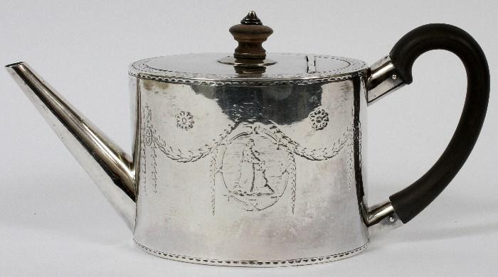 """Lot#1018, GEORGE III STERLING TEAPOT BY ROBERT MAKEPEACE & RICHARD CARTER, LONDON, 1777-78, H 4 3/4"""", L 9 1/2""""An oval sterling silver teapot with hinged lid and wood scroll handle, chased swags and oval medallions in the Adams style.  Hallmarks include a lion passant, crowned leopard, and date letter b, as well as the maker's mark for Robert Makepeace and Richard Carter (see additional photo).  Weighs approximately 14.3 troy oz."""
