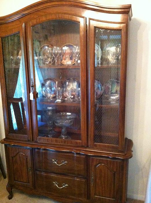 china cabinet tilled with crystal & glassware