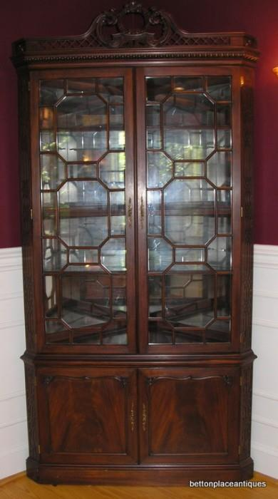 Henkel Harris Corner Cabinet lighted , one of two matching pieces.