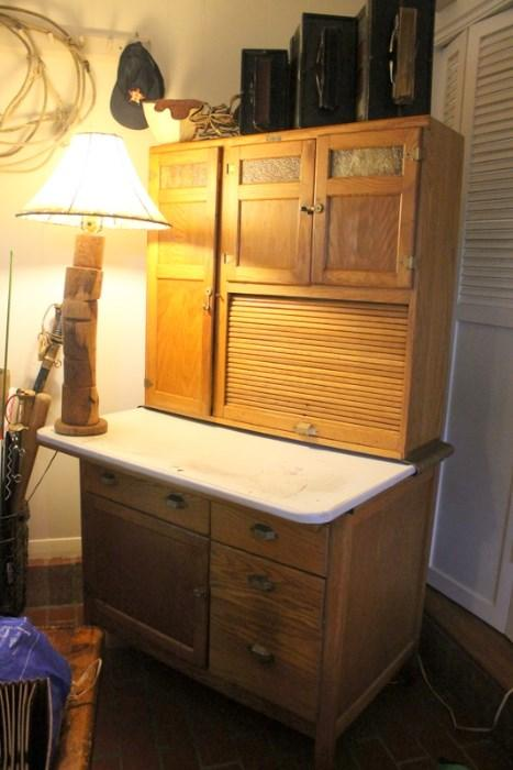 Antique Oak Hoosier Cabinet with stained glass insets on the doors
