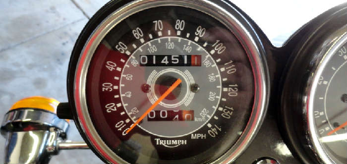 Odometer for vintage Triumph Bonneville T100 motorcycle with only 1451.1 miles in Crown City Estate Sale @ www.crowncityestatesales.com