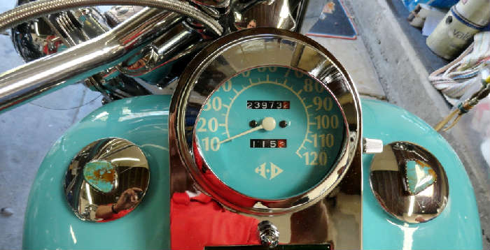 Speedometer and turquoise laden gas caps on Vintage tricked out customized southwestern style Harley Davidson motorcycle with 23,973.2 original miles @ www.crowncityestatesales.com.