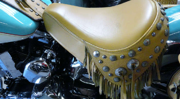 Gorgeous leather seat with studs on Vintage tricked out customized southwestern style Harley Davidson motorcycle with 23,973.2 original miles @ www.crowncityestatesales.com.