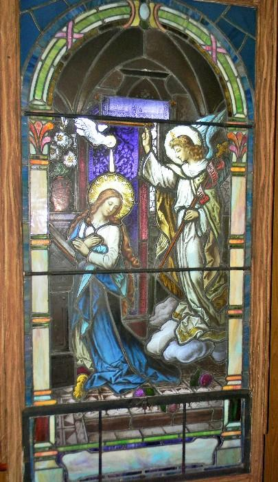 """This stain glass window is in a frame that removes from in front of the original window.  Stain glass with frame measures 6' 2 1/4"""" long."""
