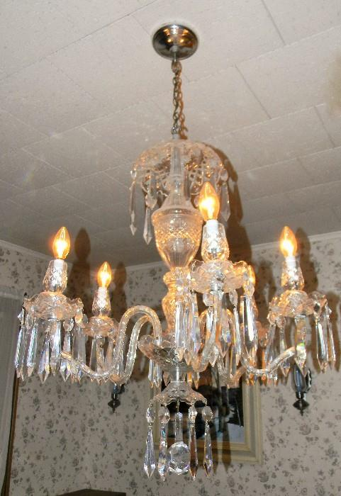 Waterford crystal Avoca chandelier.  Has extra crystals.  This is in working condition.  Buyer has option to have your own licensed electrician remove at buyers cost or at buyers request Caring Transitions staff will remove for you provided waiver is signed not holding Caring Transitions responsible for condition upon arrival at new location.