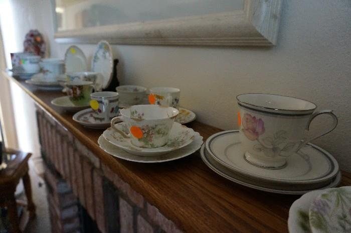 many cups and saucers