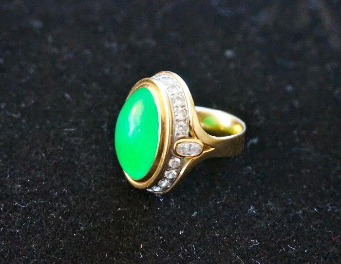 Green apple jade surrounded by good size diamonds all set is 18K gold