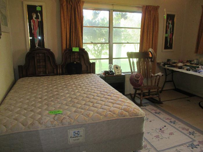 Nice Queen Size Bed and Rocker.  There are a few pictures in this room. One is a Windberg.