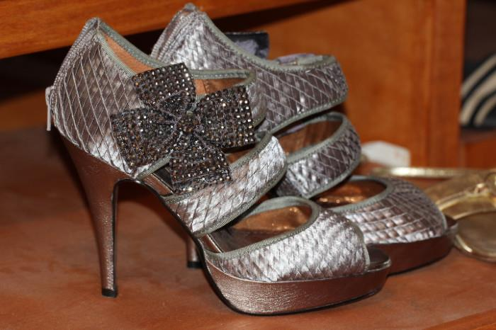 Rack after rack of gorgeous high-heeled shoes in this sale (size 7.5 -8).