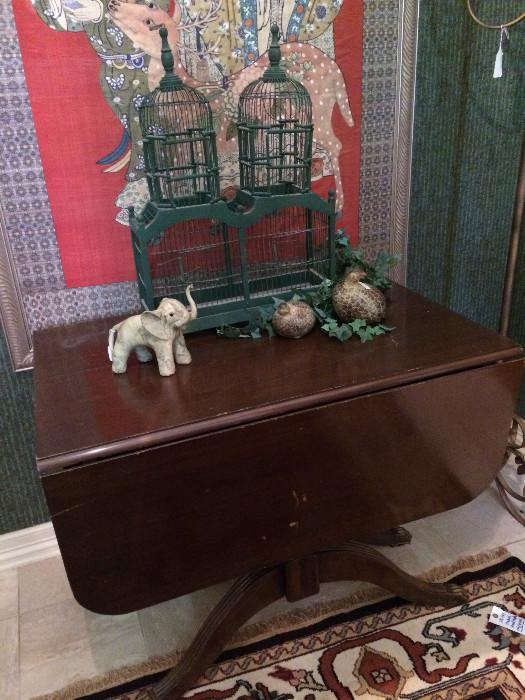 Asian wall hanging; bird cage; drop-leaf Duncan Phyfe table