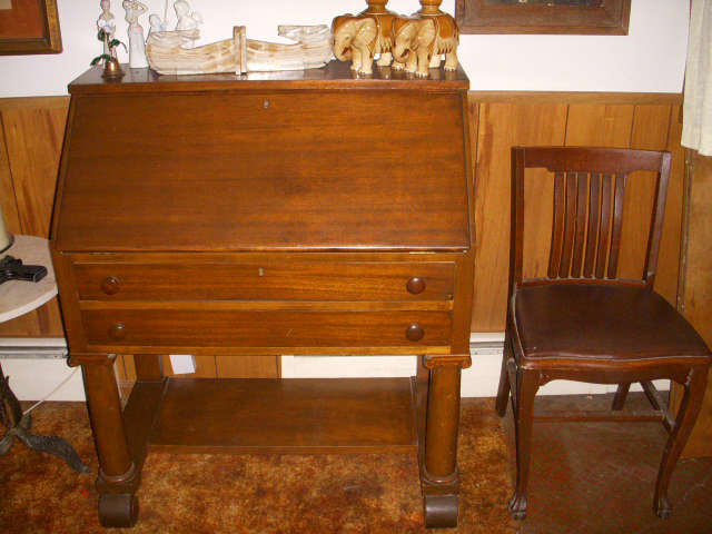 Mahogany Colonial Revival (Ca. 1910) drop-front mahogany desk with chair.  Has fitted interior.
