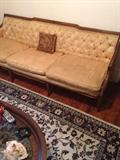 Another vintage sofa, rug, coffee table. Second floor.