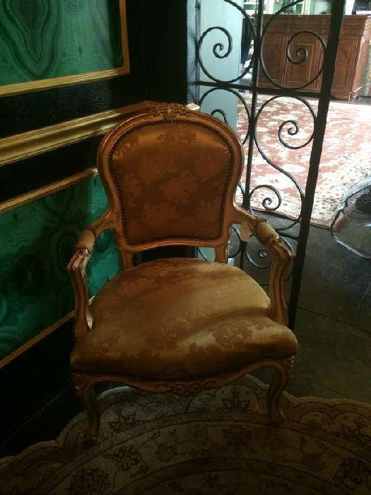 Gold French upholstered arm chair;