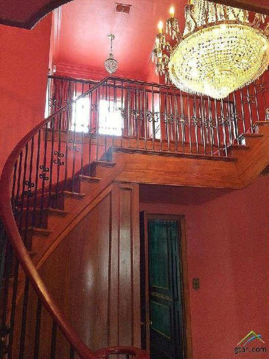This is the grand staircase for the home. The  New Orleans antique chandelier is NOT for sale.