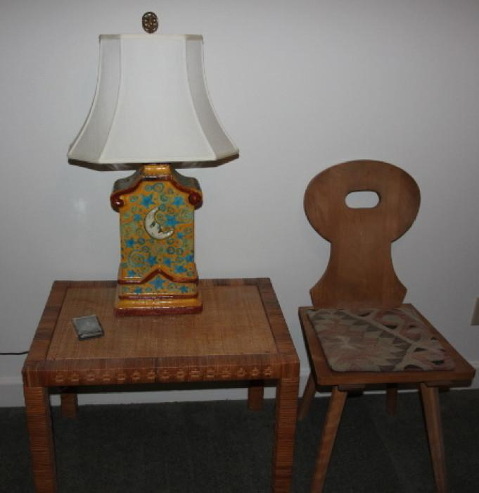 "Great ""sun/moon"" pottery table lamp, on well-made wicker table, next to one of a pair of custom-made German chairs"