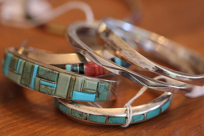 many sterling and turquoise Native American bracelets