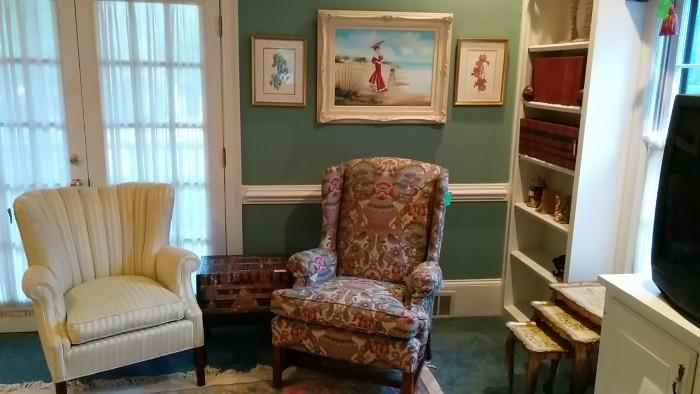 LOVE the artwork in this house. I think the artist was either an elephant, or blind. The Goldilocks chairs are actually kinda nice. There's also a nice Asian chest on stand, comfortably nestled between  the chairs.