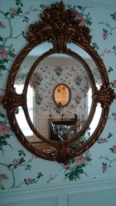 Hmm, I hadn't noticed my photographic prowess until this pic. Note the oval mirror romance happening before your eyes, just don't gag on the wallpaper...