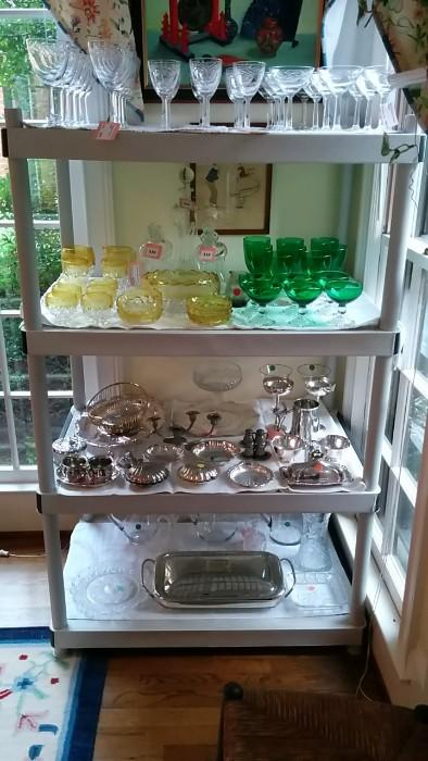 Very nice set of crystal stemware, 12 each of waters, wines and champagne coupes. A complete set of yellow/clear dessert set, green/clear waters and champagne coupes and plenty o' silver holloware for the upcoming Hallowthankwanzaristmas holidays.