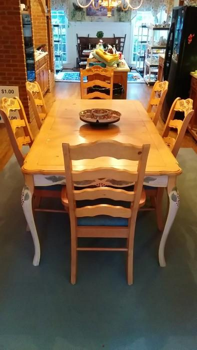 """Here's the table that completes the """"French Country"""" Holy Trilogy. Who knew you could mix French Country with an Imari-style lazy susan. It set of fireworks of interior design ideology, but works in strange and mysterious ways. Look at the legs on that table! Inspired by Betty Grable?"""