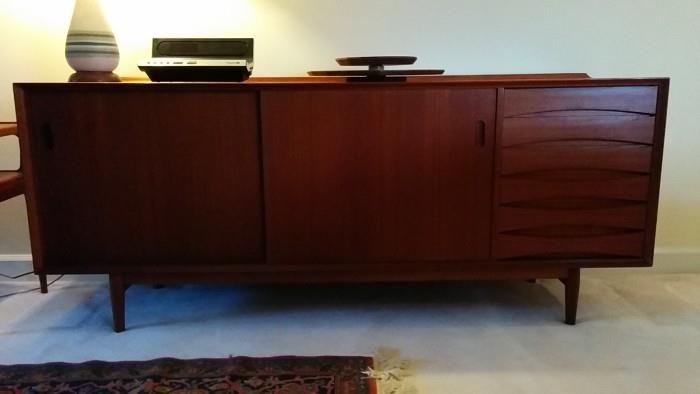 Makes you wanna slap yo Momma Mid-Century Teak Danish buffet, by Arne Vodder. You really have to see this piece, it's quite the real deal. Topped by a bowling pin lamp and teak lazy susan.