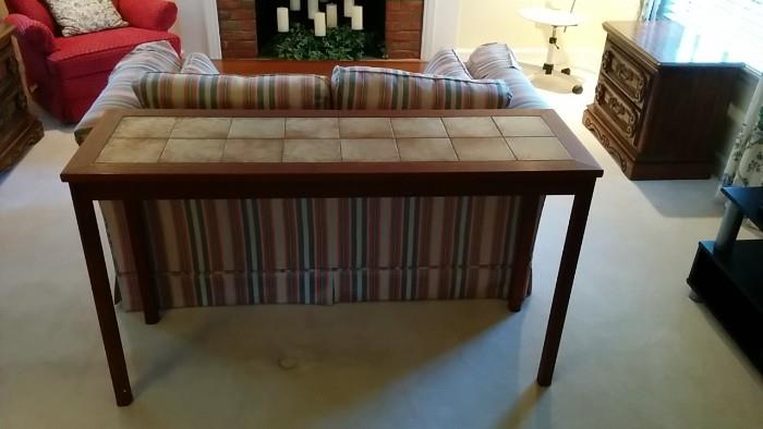It's Mid-Century, just not so cool as the preceeding items. It has a tile inset top, perfect for Winter fondue parties.