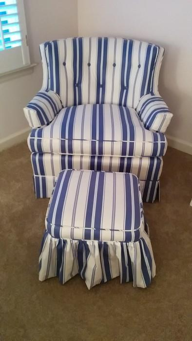 Very cute blue/white striped armchair and matching ottoman. The vintage chair hiding under the curtain is 1950's.