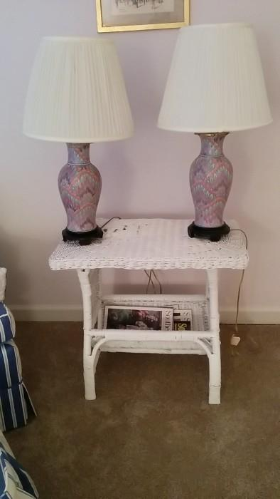 Wicker magazine rack - nice rack! Topped by a pair of Asian-y lamps. Did you expect a bottom?!?
