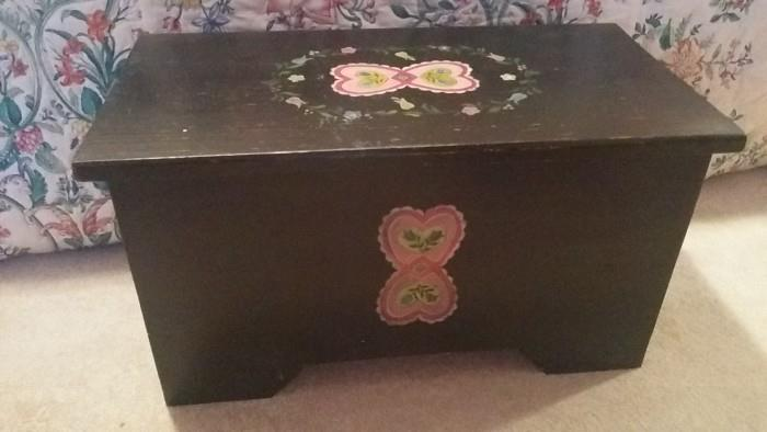 Aw, a cute, painted box at the foot of the bed.