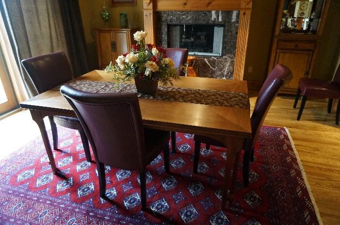 Teak dining table with 6 chairs and 3 leafs