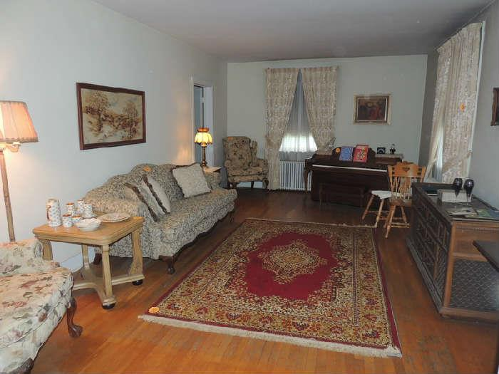 quality pair of wing back chairs and camel back sofa with wood carved lets, wool 6x9 rug, art, lamps, vintage stereo