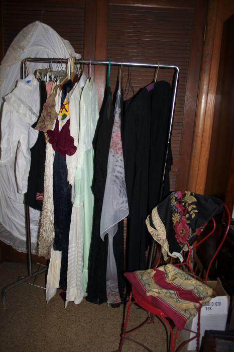 Antique ladies clothing, including a hoop slip hanging in the back