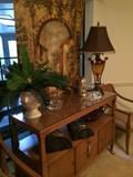 Danish server (top extends); tapestry; scones; small clocks; one of many lamps