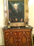 Exquisite  antique marble top chest; pair of brass candelabras;  framed portrait.