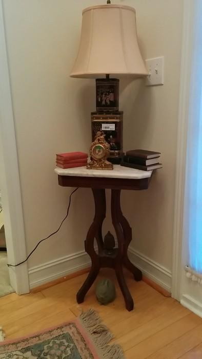 Victorian, marble-topped table with tin Asian lamp, vintage clock, fossilized floor bunny