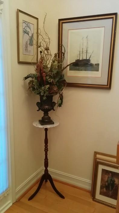 "decent artwork, marble-topped stand, OK ""silk"" flower arrangement"