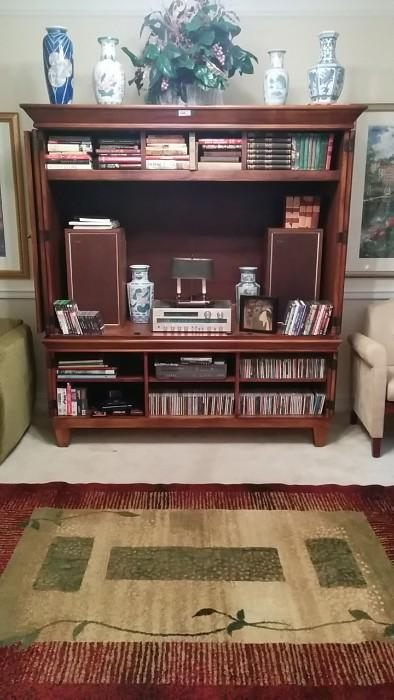 Nice wooden entertainment center by Romweber, quite heavy, two pieces, cheap, ugly rug, six Asian vases, decorative - not something you'll see evaluated on Antiques Roadshow.