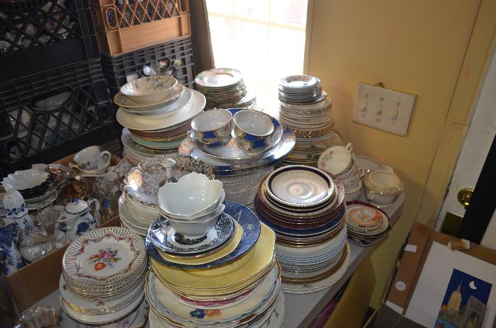 Porcelain plates and tea cups including many by well-known makers, in many highly sought after patterns
